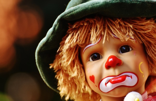 sad-clown-face-on-doll